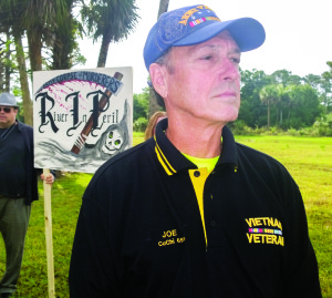 Photo by Patrick McCallister  Army veteran Joe Howard, Port St. Lucie, joined hundreds protesting slowed progress on the Central Everglades Planning Project by the Army Corps of Engineers at a mock funeral for the Indian River Lagoon on Saturday, May 3.