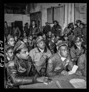 Source: Wikimedia Commons Then-Flight Officer Hiram E. Mann, left, front, joins other members of the 332nd Fighting Group, U.S. Army Air Corps, at a briefing at their base in Ramitelli, Italy, before flying on a bomber escort mission to Germany in March 1945.