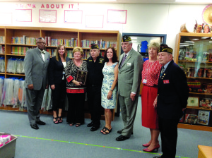 Photo courtesy of Soo Keller Fairlawn Elementary Magnet School, Port St. Lucie, teacher Shirley Helton recently received the Veterans of Foreign Wars Smart/Maher National Citizenship Education Teacher of the Year award. From left are Kevin Perry, assistant superintendent, St. Lucie School District; Lydia Martin, executive director of schools; Jennifer Hedeen, principal, Fairlawn Elementary; T. Wayne Markham,  commander, VFW Florida; Shirley Helton; Daniel Duffy, National VFW Council Administration; Genelle Yost, superintendent, St. Lucie School District; and Jack Willis, VFW District 11 commander.