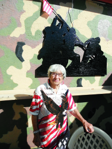 Staff photo by Mary Kemper Vera Pochopin, 98, shown here standing outside AMVETS Post 92, Rio, is still going strong with activities in several veterans' auxiliaries.