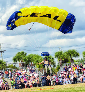 Mitch Kloorfain/chief photographer Navy SEAL (retired) Rick Kaiser, executive director of the UDT Navy Seal Museum in Fort Pierce, took part in the annual Muster by joining in on the precision parachutist display before switching hats to his role as host and emcee of the event Saturday, Nov. 9.
