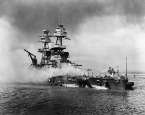 Source: Wikimedia Commons The U.S. Navy battleship USS Nevada is shown beached and burning at 9:25 a.m. on Dec. 7, 1941, after being hit forward by Japanese bombs and torpedoes. Her pilothouse area is discolored by fires in that vicinity. The harbor tugboat, Hoga, is alongside Nevada´s port bow, helping to fight fires on the battleship's forecastle.