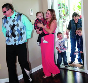Photo courtesy of Frank Maitland Army Sgt. Jorge Gutierrez and his family walk into their new house for the first time.
