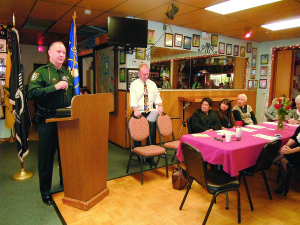 Staff photo by Mary Kemper Indian River County Sheriff Deryl Loar speaks at a Celebration of Life ceremony for the late Chief Petty Officer Charlie Cox, who recently died just short of his 105th birthday, at Vero Beach Veterans Inc. headquarters, Vero Beach, Feb. 4. Listening are, from left, Indian River Veterans Council Vice President Curtis Paulisin and Cox's widow, Busilisa, and family and friends.