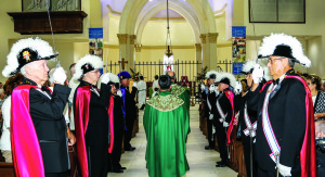 Photo courtesy  of Marisol Guntkowski The Knights of Columbus 4th Degree Color Corps lines the aisles of St. Bernadette Catholic Church, Port St. Lucie, at a funeral mass conducted for a fellow Knight in January.