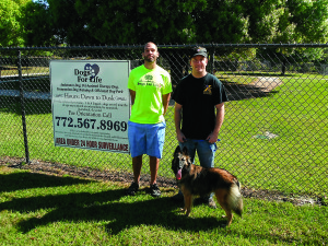 Staff photo by Mary Kemper Former Army Sgt. Jay Harris, left, has been hired full-time at Dogs For Life, Vero Beach. He is seen here with Marine veteran Daniel Votrobek, who, along with his dog, Ariel, is undergoing training for special needs.