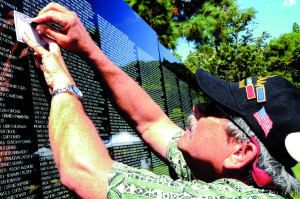 Source: Wikimedia Commons The Vietnam and All Veterans of Brevard, who host the Vietnam Traveling Memorial Wall all over the U.S., will present the Wall at events honoring Vietnam and Iraq and Afghanistan veterans in Jupiter April 8-12. Subsequently, the Wall will occupy pride of place at the Brevard veterans' 28th annual reunion, slated April 20-26 in Melbourne. In this photo, Vietnam veteran Jerry Turrieta takes a rubbing of a friend's name during a display of the Wall in Garden Grove, Calif., Sept. 10, 2014.
