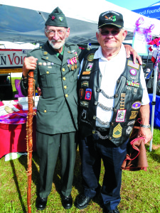 Staff photo by Mary Kemper World War II veteran George Norris, Palm Bay, left, attended the 28th annual Vietnam and All Veterans of Brevard reunion April 17, in support of Vietnam veterans like his friend, Rolling Thunder Florida 1 chapter president James 'JJ' Justice, right.