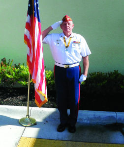 Staff photo by Mary Kemper Marine Corps veteran Gregg Mann, Port St. Lucie, is sergeant-at-arms for the Jack Ivy 666 Detachment of the Marine Corps League in Port St. Lucie. Here, he salutes the flag at American Legion Post 318, Port St. Lucie.