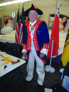 Staff photo by Mary Kemper At the Jetson Electronics and Appliance Veteran Information Day, held at its U.S. Federal Highway 1 location in Port St. Lucie, Jay Wise dresses in period costume to bring attention to the Sons of the American Revolution. Wise is the Yorktown Camp Color Guard commander for the St. Lucie River chapter, Florida Society.