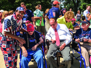 Photo courtesy of Shamsher Singh Port St. Lucie dermatologist Dr. Shamsher Singh, left, escorted World War II veteran Eugene Wright, center, who fought in the Battle of the Bulge and the Bridge at Remagen in World War II, on an Honor Flight this year to Washington, D.C., as a guardian. Also attending was former U.S. Sen. Robert Dole, Kansas, right, with wife Elizabeth standing behind him.