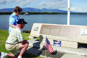 Source: Wikimedia Commons On Dec. 6, 2002, USS Nevada survivor Woodrow Derby and his wife look silently at photographs and flags they have placed on the USS Nevada Memorial in Hawaii. Derby was an honored guest for the upcoming Pearl Harbor Day commemoration aboard the USS Arizona Memorial. The ceremony featured guest speaker the late Sen. Daniel Inouye of Hawaii and the attendance of 16 Pearl Harbor survivors and their family members.