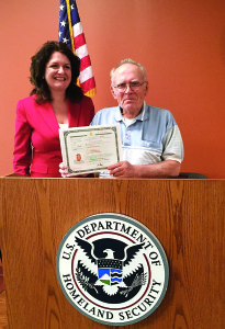 Photo courtesy of Elizabeth Ricci  Vietnam Vet Erhard Wensel with immigration attorney Elizabeth Ricci, who helped naturalize Wensel in Philadelphia in April. The 73-year-old found out he wasn't a citizen when he filed for Social Security benefits.