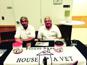 Photo courtesy of Tony Reese Kevin Donahue, right, and Larry McPhillips man a table at the June 11 Veterans Assistance event for the House-A-Vet Project, which seeks to pair needy vets with a permanent home. On July 25, House-A-Vet will conduct a fundraiser at AMVETS Post 92 in Rio.