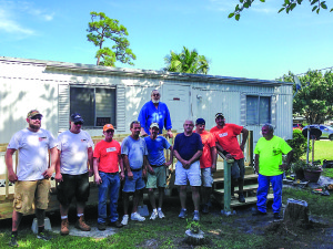 Photo courtesy of Kevin Donahue Volunteers from the St. Lucie West Home Depot join House-A-Vet members in building a ramp at the home of disabled Vietnam veteran Richard Trainor, standing, center. Fourth from left is House-A-Vet member John 'Johnny O' Osberg; fifth, Scotty 'Scooter' Satterthwaite; sixth, Pete 'Palm City Pete' Ellis; and 10th, Larry 'Radar' McPhillips.