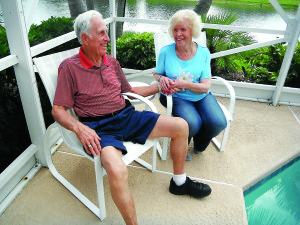 Staff photo by Mary Kemper Newlyweds Fred and Pat Quackenbush take a break at their home in the Cascades of St. Lucie West June 25.