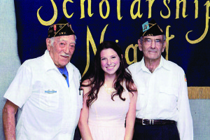 Image courtesy of Jerry Shapiro and Harvey Toback Jewish War Veterans Post 549, Stuart, awards a deserving high-school student from Martin County a scholarship for $1,500 for their first year toward college. Paige Theodore, center, Palm City, received her scholarship from World War II Army veteran Jerry Shapiro, left, vice commander, and Army Korean War veteran Harvey Toback, at a ceremony held April 14 at Wanda H. Yarboro Auditorium, Martin County High School, Stuart.