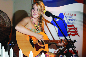 Mitch Kloorfain/chief photographer Cassidy Diana, of Palm City shared her upcoming performance schedule and her connection to the Coalition to Salute America's Heroes following a performance at Vine & Barley in St. Lucie West last week.
