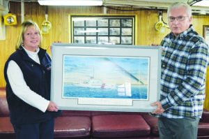 Photo courtesy of Roy Brewer Roy Brewer, vice chairman of the United Veterans of St. Lucie County, presents a print of the U.S. Coast Guard Cutter-Icebreaker Mackinaw aboard the ship, which is now a museum exhibit, to Lisa Pallagi, executive director of the Maritime Museum, on Saturday, Oct. 3, in Mackinaw City, Mich.