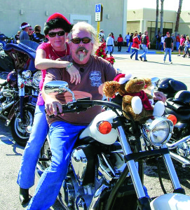 Photo courtesy of ABATE Rik and Tracy Venerable enjoy the annual Christmas Toy Run.
