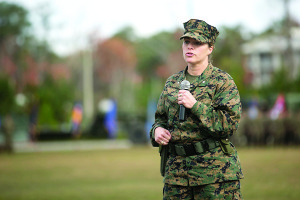 """Lt. Col. Lauren Edwards gives a speech during the 8th Engineer Support Battalion change of command ceremony at Camp Lejeune, N.C., Nov. 30. """"I'm extraordinarily proud to take command of 8th ESB today, and I hope that all Marines and Sailors in this battalion recognize that if they work hard and look out for each other they can accomplish whatever they the set their minds to,"""" said Edwards. Edwards' new responsibility, as the first female commander of an ESB, will be to provide engineer support to II Marine Expeditionary Forces.  (U.S. Marine Corps photo by Cpl. Ryan Young/ released)"""