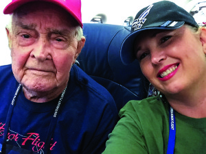 Photo courtesy of William Bryant Jr. World War II  and Army Air Corps (and subsequently Air Force) veteran William Bryant takes a break on the May Southeast Florida Honor Flight with his guardian, Justy Anuszewski. Both are Vero Beach residents.