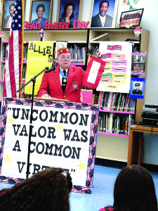 Staff photo by Mary Kemper Marine Corps veteran Hershel 'Woody' Williams, an Iwo Jima recipient of the Medal of Honor, gives a talk to the students of Northport K-8 School in Port St. Lucie Feb. 8.