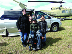 Staff photo by Mary Kemper Disabled Marine Corps veteran Jason Picaro, along with his wife, Melisa, and their children Kalena, 8, and A.J., 4, pose in front of a custom van given to them via a donation to the Veterans Council of Indian River County. The presentation of the van was made at the Military Expo held Feb. 6 at the Indian River County Fairgrounds.