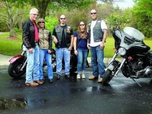 Staff photo by Mary Kemper At the motorcycle run held March 20 beginning at Veterans Memorial Park, Port St. Lucie, by the Gold Star Family Memorial Committee of the United Veterans of St. Lucie County, a contingent of Moose Riders, Port St. Lucie, participated. From left are Ken and Mary McConnell, Jeff Dybus, Rebecca Morris and T.J. Bayer.