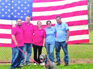 Photo courtesy of Courage on All Fronts  David Merrill, far left, is a Marine Corps veteran with post-traumatic stress disorder. He's getting a service dog from Courage on All Fronts, founded by Michael and Alicia Cheplick, beside him. Courage on All Fronts recently got a $10,000 donation from the LCpl Justin J. Wilson (US Marines) Memorial Foundation. That organization, better known as Justin's Wings, was founded by Fran and Lance Wilson. That donation is getting Recon, front, trained to help Merrill handle everyday stresses that can trigger PTSD responses.