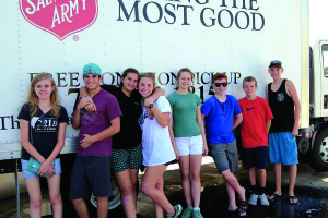 Photo courtesy of Salvation Army The Palm City Presbyterian Youth Ministry volunteered at the Salvation Army's Family Store as part of their mission trip. Pictured are Amelia Johnson, left, Leo Cusamano, Sophia Franco, Leanna Livings, Marie Bartnick, Nathan Welmaker, Sam Johnson and Shawn Murphy.