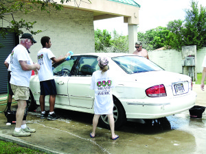 Staff photo by Mary Kemper An enthusiastic crew washes a car July 23 at the Auto Zone in Port St. Lucie to benefit Wreaths Across America in St. Lucie County.