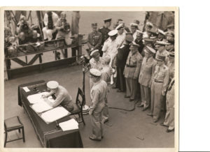 Admiral Nimitz signs